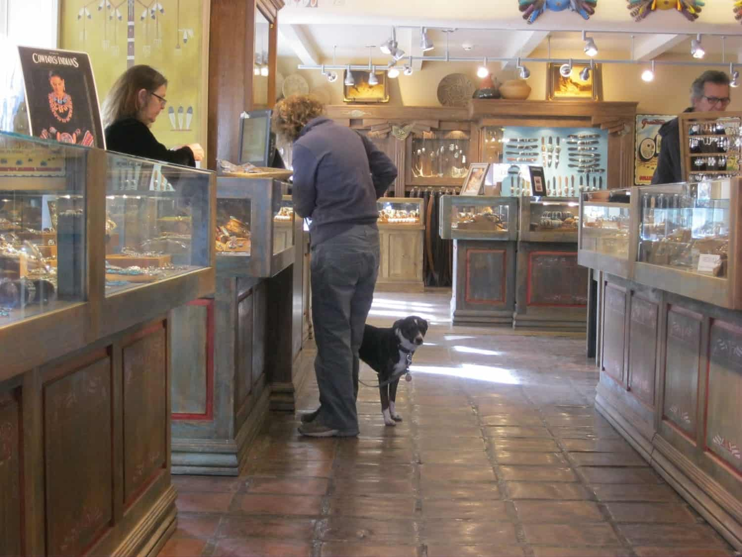 Dog and person shopping in Santa Fe, NM