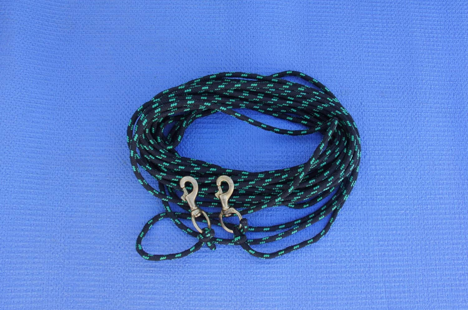 Coiled rope with snap clips attached to each end