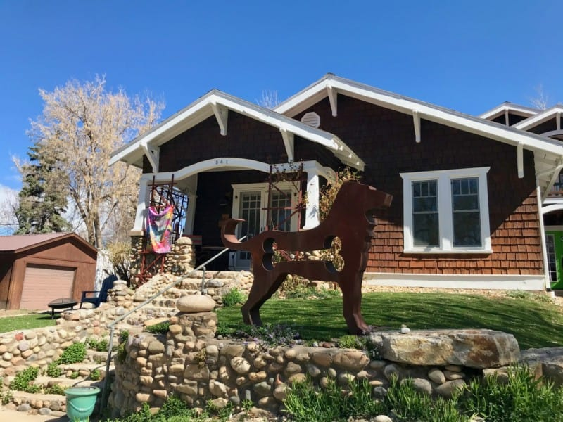Dog sculpture in front of a home in Durango, CO