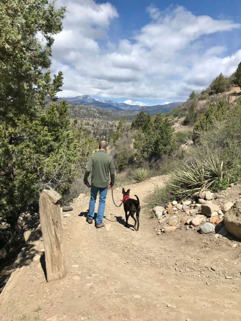Man and dog on the dog friendly nature trail in Durango, CO