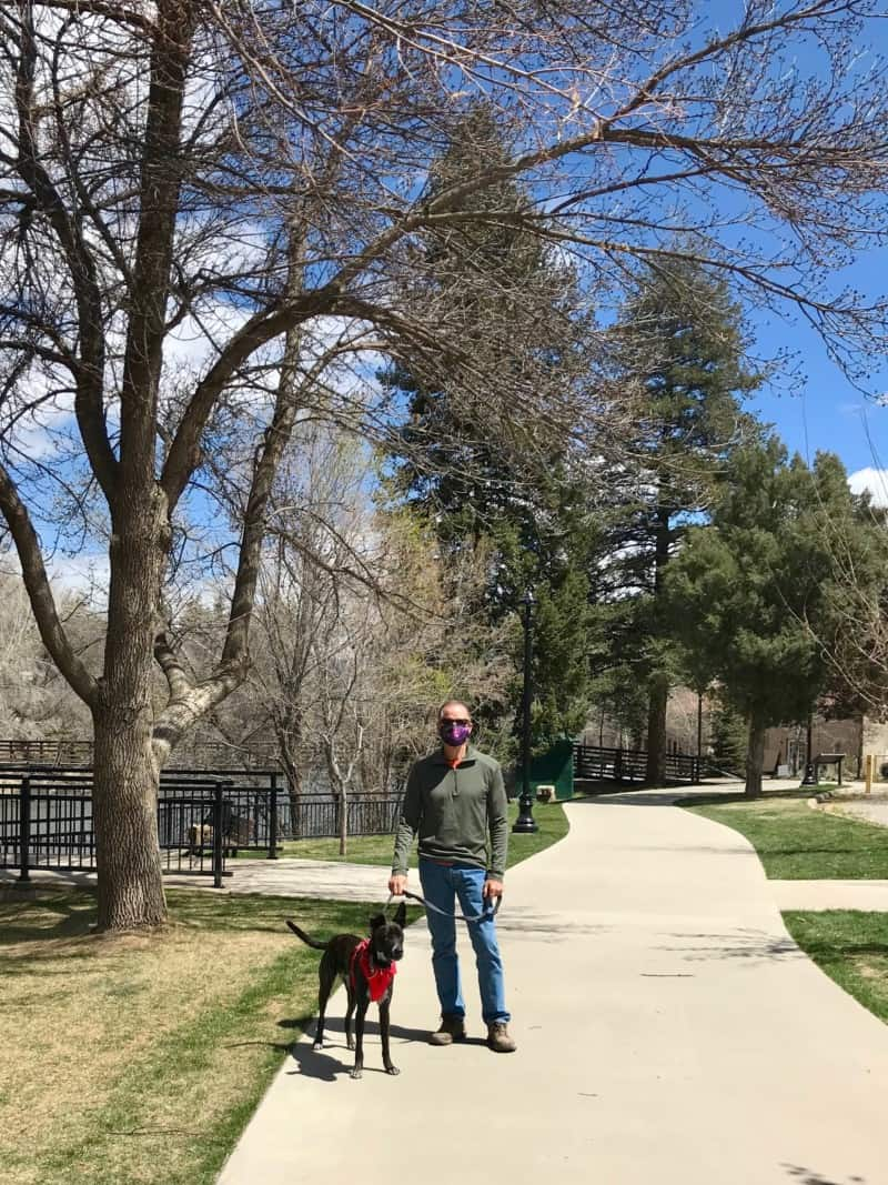 Man and dog on the Animas River Trail in downtown Durango, CO