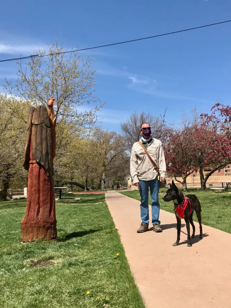 Man and dog walking on the pet friendly River Trail in Santa Fe, NM