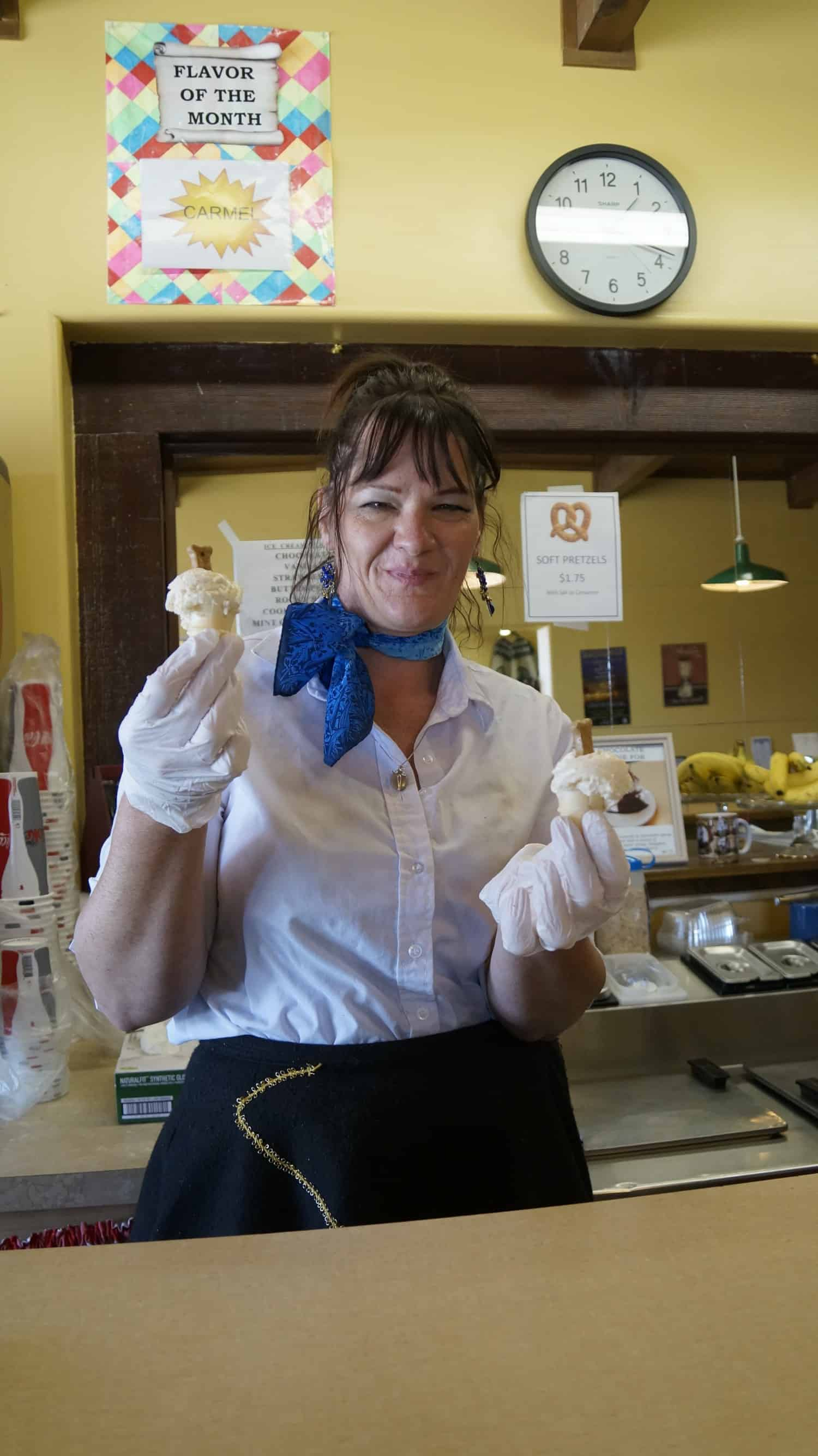 Waitress serving doggy ice cream cones in pet friendly Tombstone, AZ