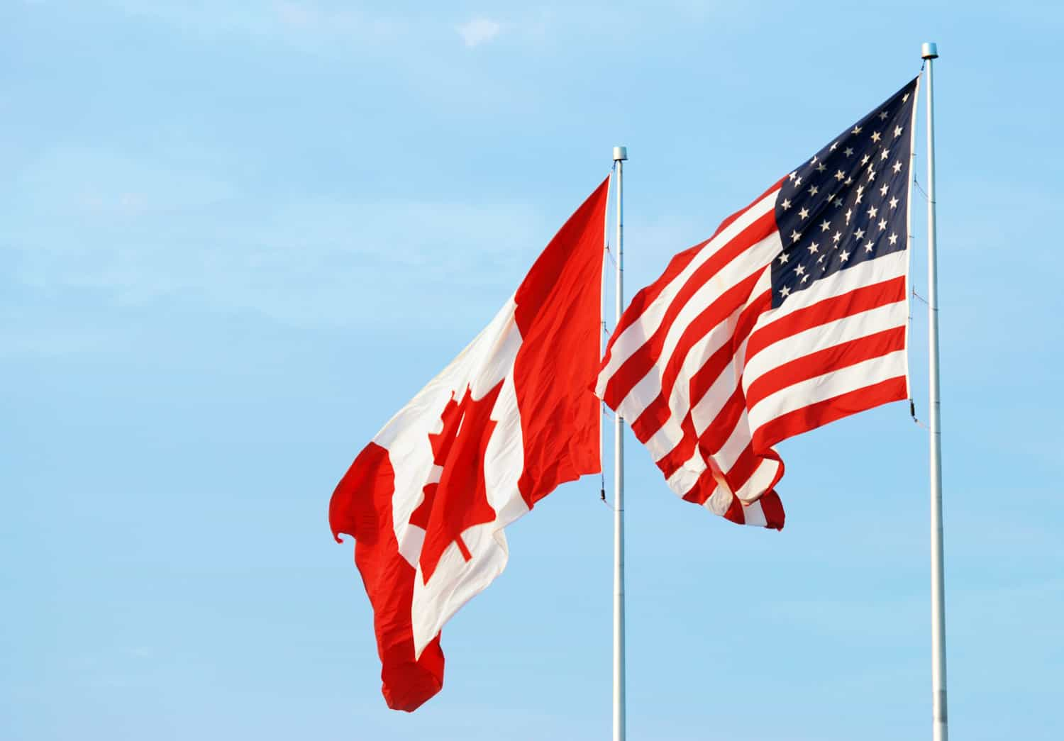 The Canadian and U.S. flags flying side-by-side