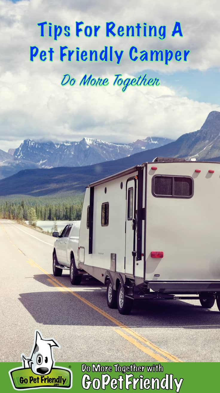 Truck and Pet Friendly Camper on highway heading toward snow-covered mountains