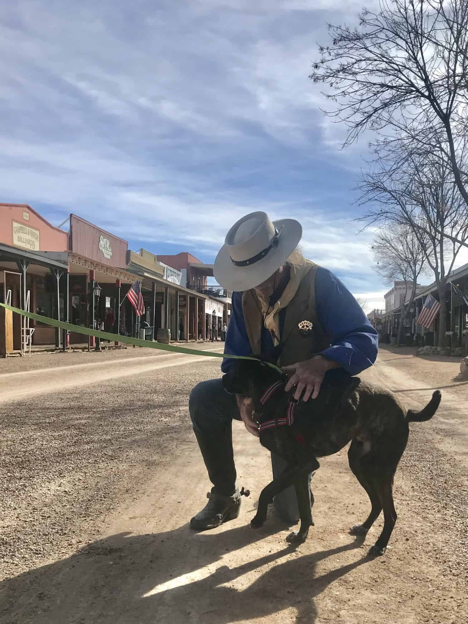 Deputy petting a bridle dog in Tombstone, AZ