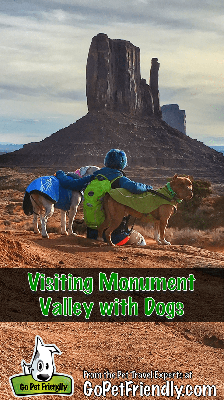 Woman with her dogs on a pet friendly trail in Monument Valley, Utah