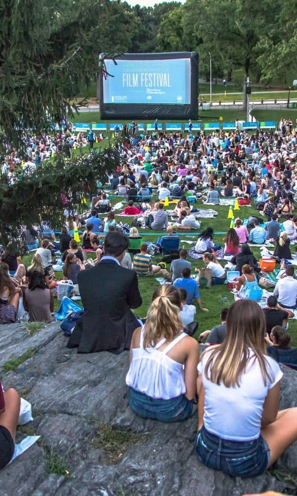 Crowd watching movies at the Central Park Conservancy Film Festival.