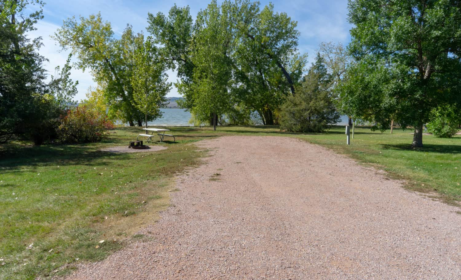 A campsite backing up to the beach at pet-friendly Angostura Reservoir in South Dakota's Black Hills