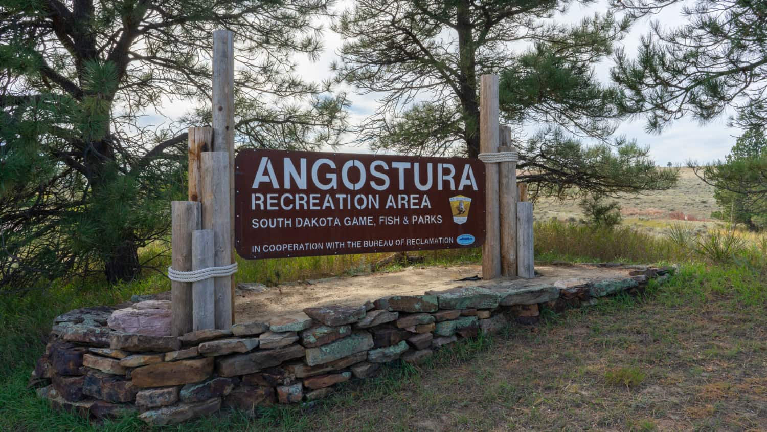 Entrance sign for pet-friendly Angostura Recreation Area in South Dakota's Black Hills
