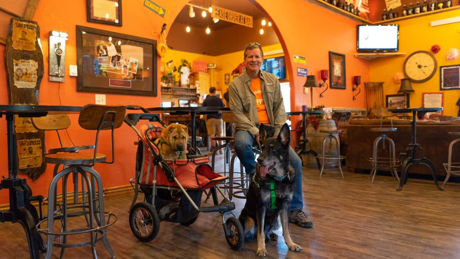 Rod, Ty, and Buster from GoPetFriendly.com in the pet-friendly tasting room of Naked Winery and Sick-N-Twisted Brewing in Hill City, SD