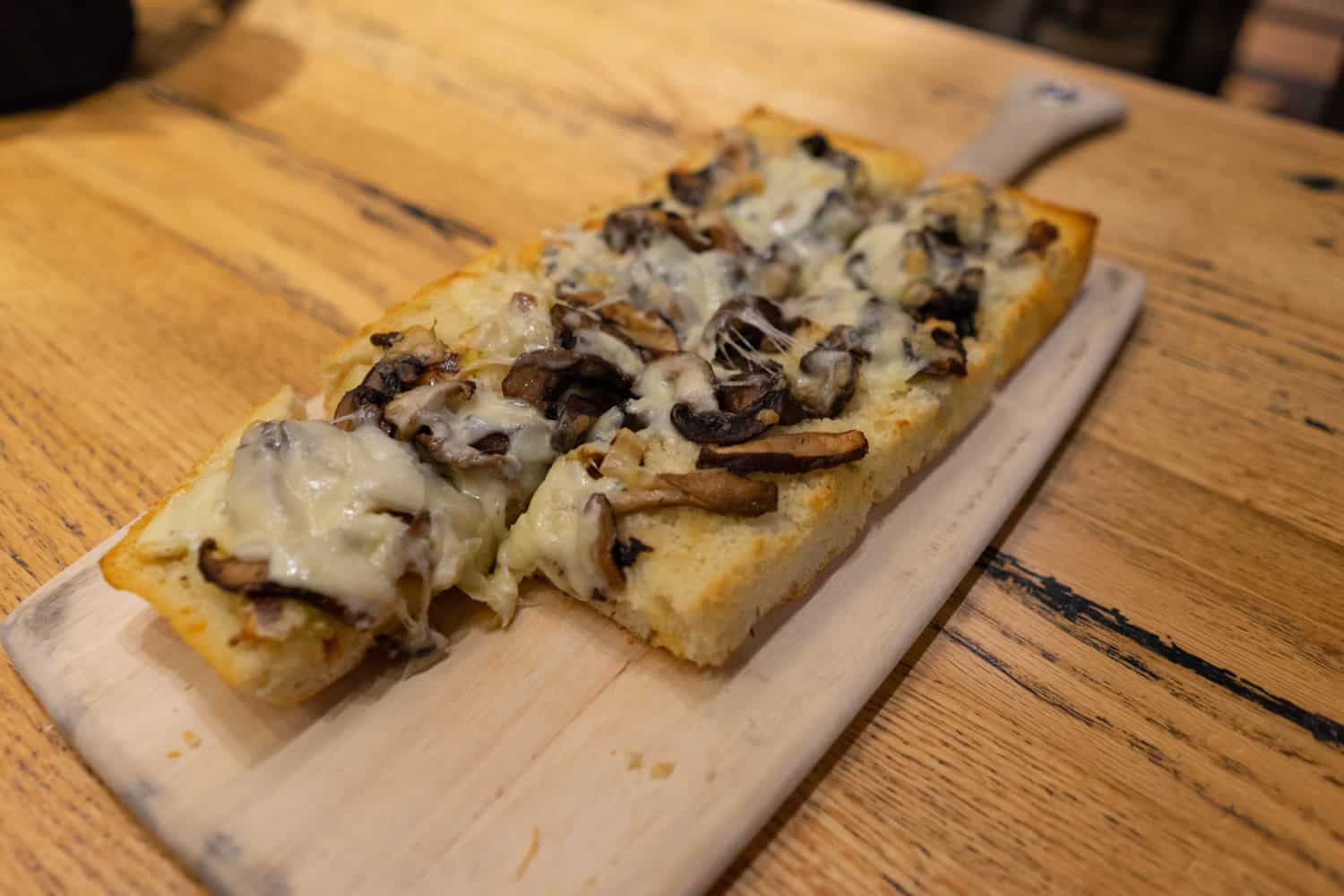 Wild mushroom focaccia pizza at pet-friendly Prairie Berry Winery in Hill City, SD