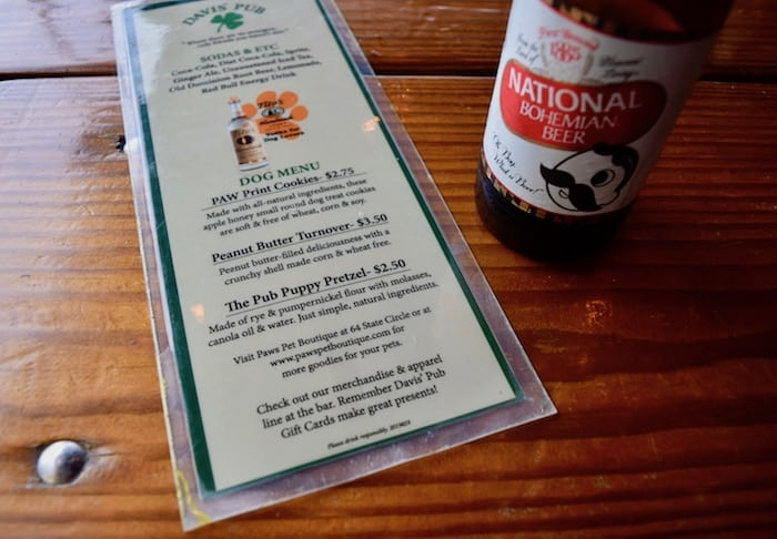 Davis's Pub even has a menu for dog diners! (Dog menu beside beer bottle.)