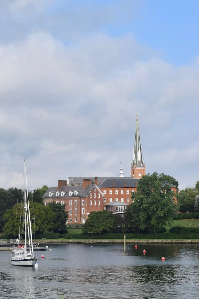 St. Mary's Church with sailboat on mooring field in foreground.