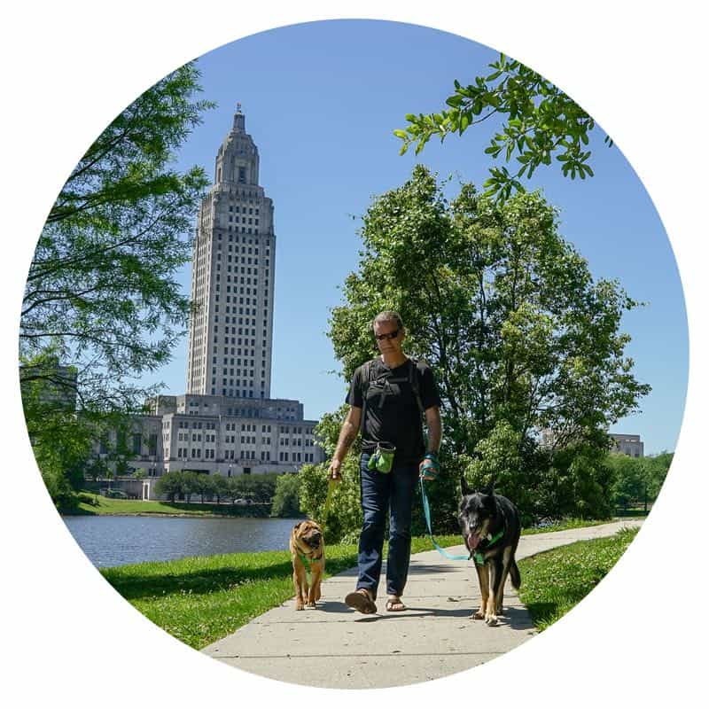 Rod, Ty, and Buster from GoPetFriendly.com walking the pet-friendly trails around the LA Capitol Building in Baton Rouge