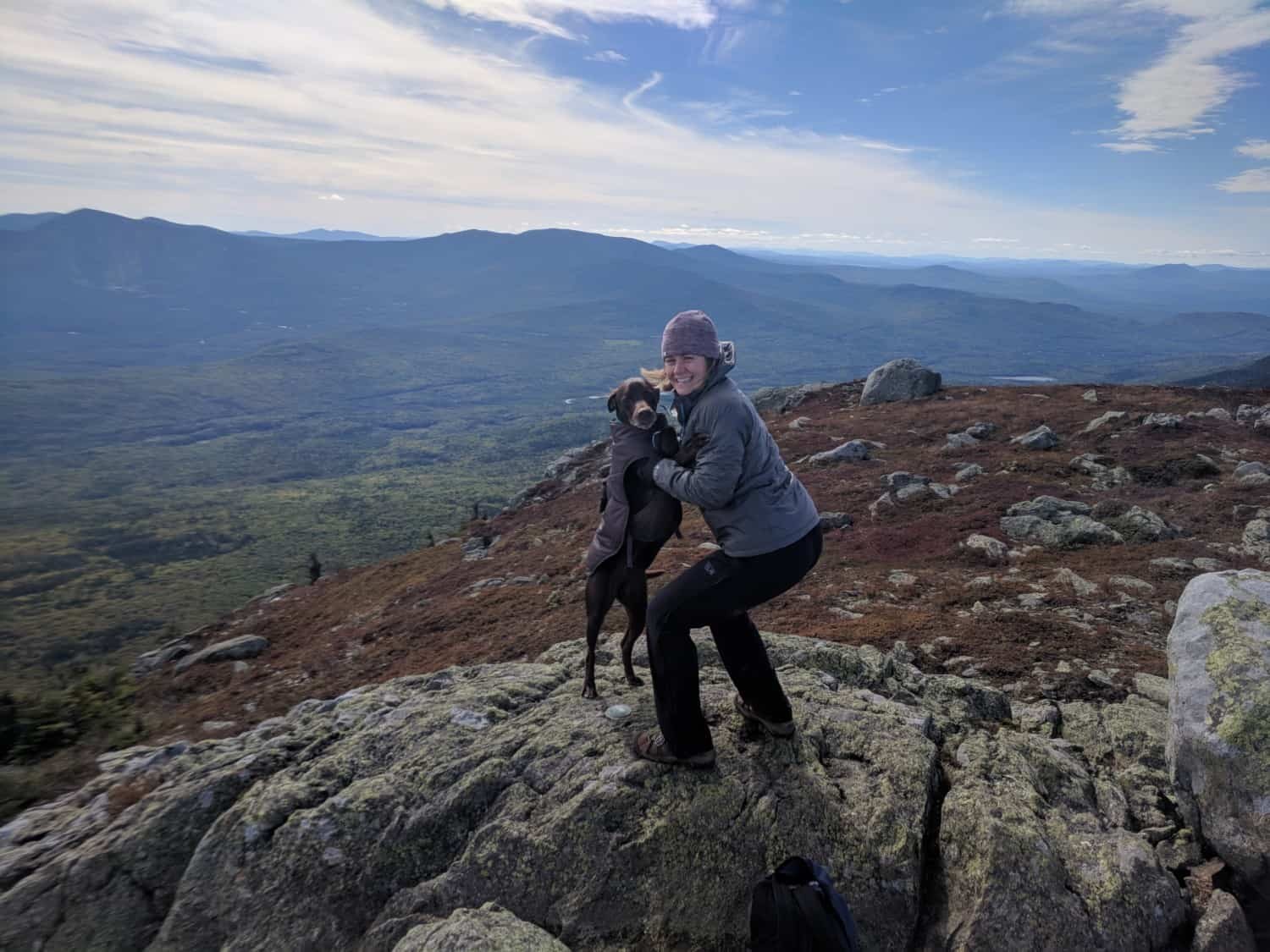 Dog and woman hiking the pet friendly Appalachian Trail in Maine