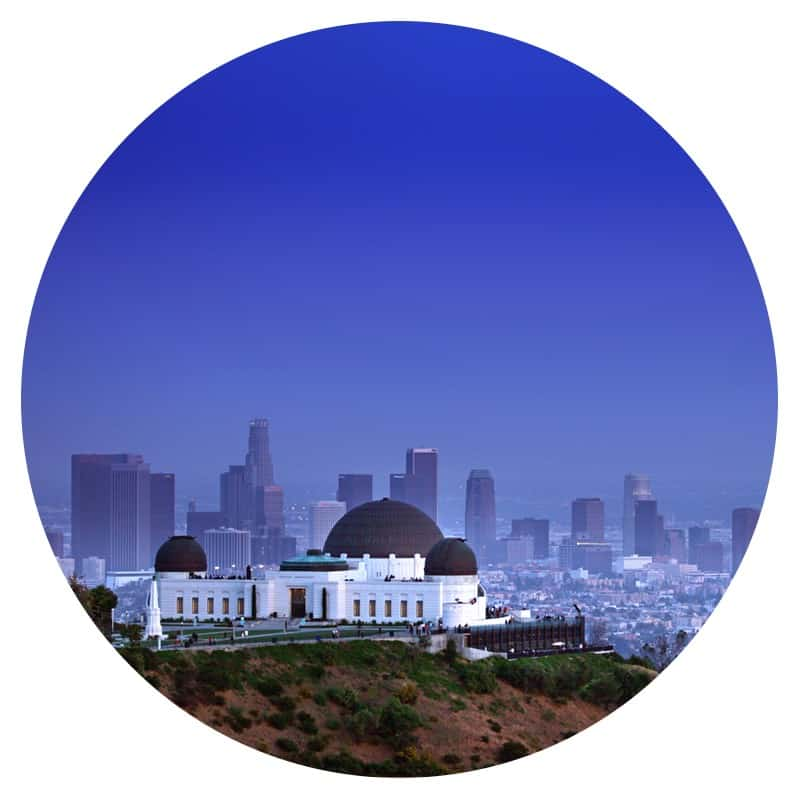 Photo taken from a pet friendly trail of Griffith Park Observatory with the Los Angeles skyline in the background.