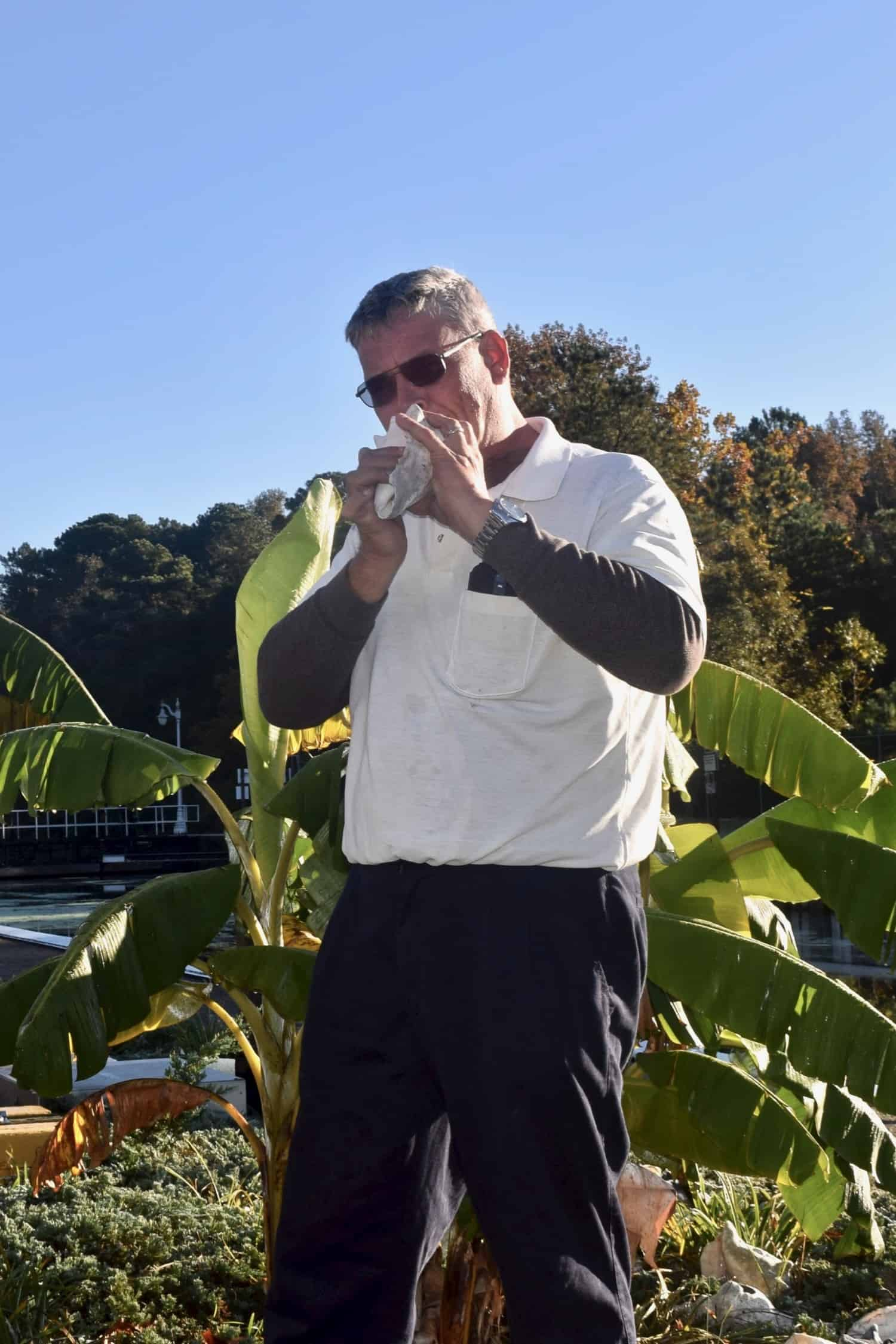Dismal Swamp lock master, Robert, blowing a conch shell