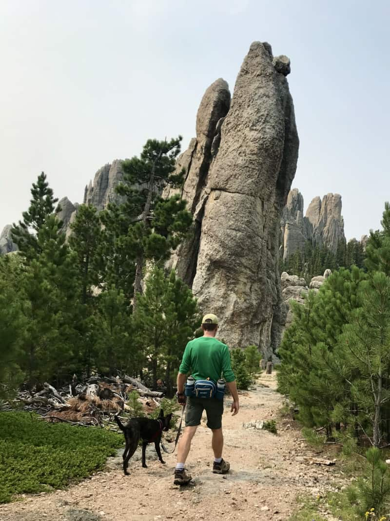 Man and dog walking pet friendly Trail #4 in Custer State Park, South Dakota