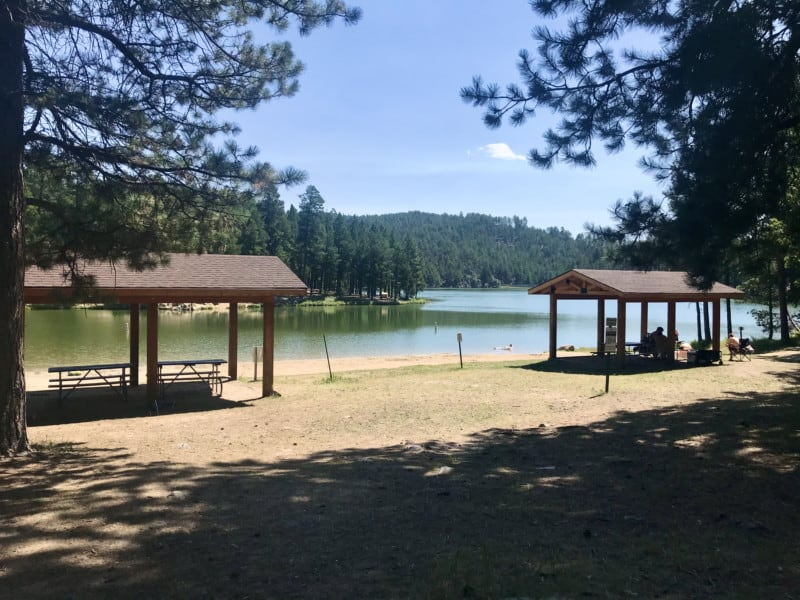 Pavilions, picnic tables and beach at Center Lake at Custer State Park, South Dakota