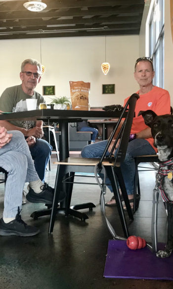 A woman, two men, and a dog at the pet friendly tap room at Cohort Craft Brewery in Rapid City, SD