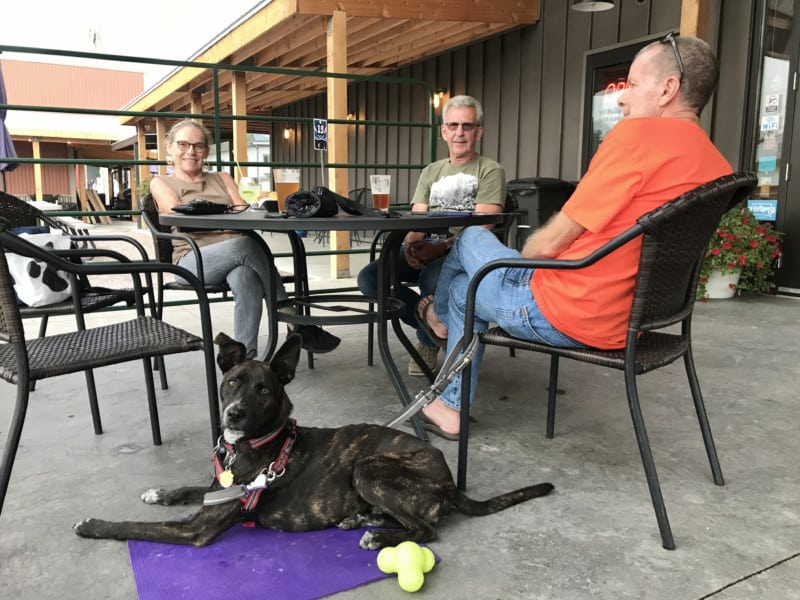 Woman and two men on the pet friendly porch at Custer Beacon in Custer, SD