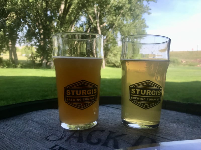 Two beers on an outdoor table at Sturgis Brewing Company in Sturgis, SD