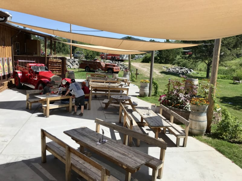 Pet friendly back patio at Firehouse Smokejumper Station brewery in Hill City, SD