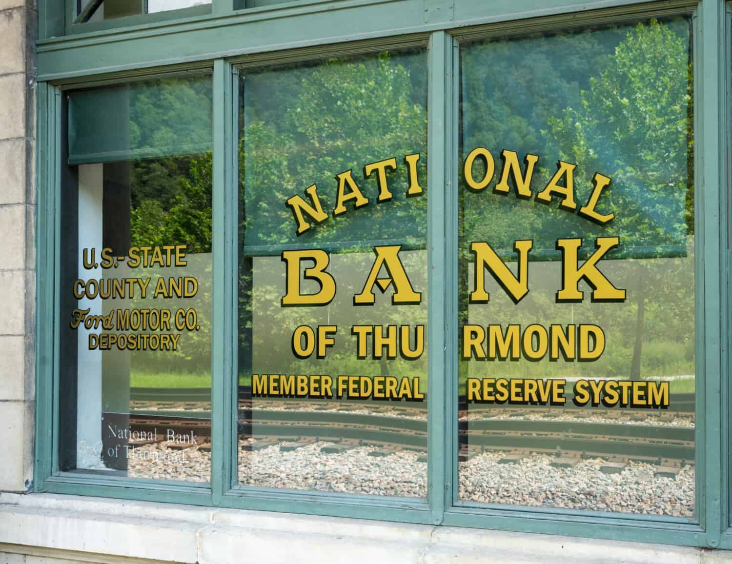 Window of the National Bank of Thurmond in the pet friendly ghost town of Thurmond, WV