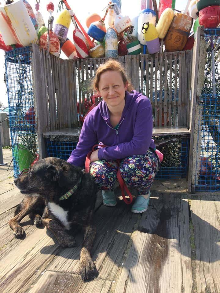 Woman and dog on Cape Cod, MA
