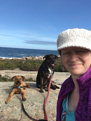 Woman and dogs in New England at pet friendly at Halibut Point State Park, MA