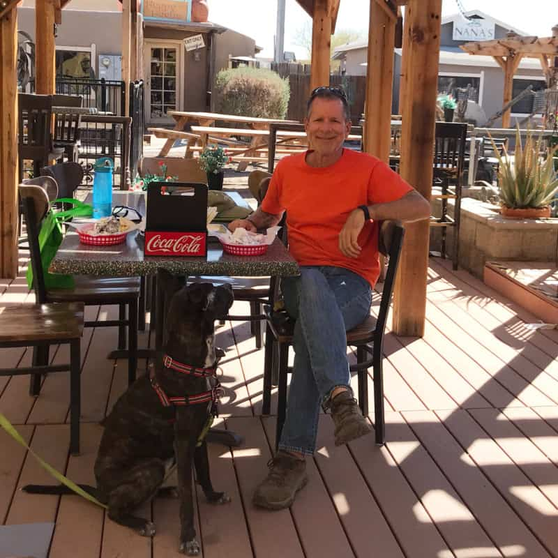 Man and dog sitting on the pet friendly patio at the Pita Patio Grill in Coolidge, AZ