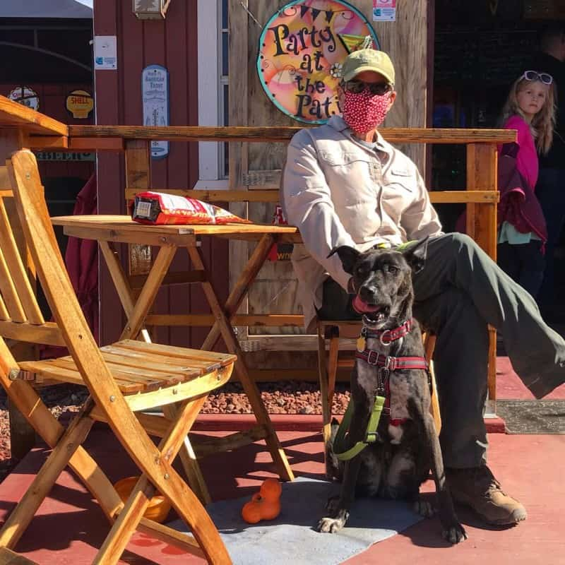 Man and dog sitting at a dog friendly brewery in Sonoita, AZ