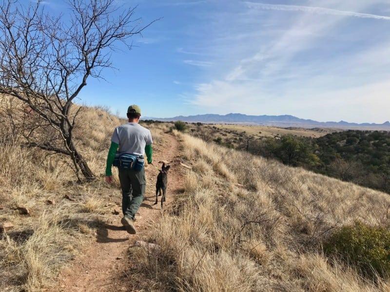 Man and dog on a pet friendly trail near Sonoita, AZ