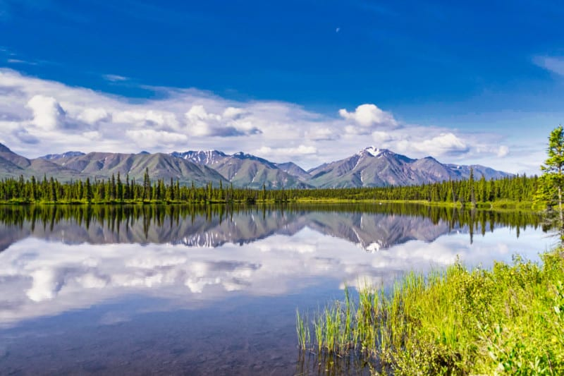 Lake with mountains in the background in Wrangell-St. Elias National Park and Preserve in Alaska